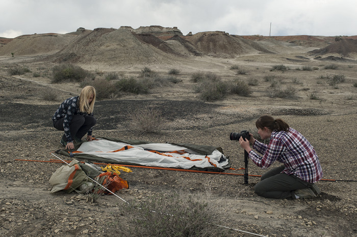Director Lexi Jamieson Marsh filming Dr. Lisa Boucher as she sets up camp in the Bisti/De-Na-Zin Wilderness Area. © 2015 Kelsey Vance